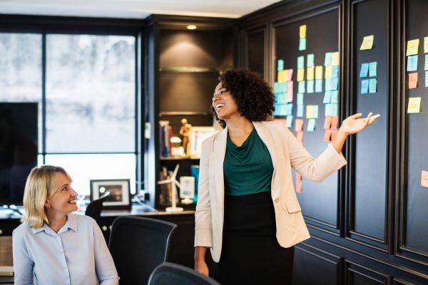 women talking work